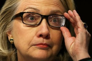 Hillary wearing Fresnel prism, an indication that she is suffering from double vision.